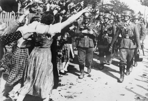 THE GERMAN OCCUPATION OF THE SUDETENLAND, 1938 (HU 5509) German women welcome German troops in the Sudetenland, Czechoslovakia, on 1 October 1938. Copyright: © IWM. Original Source: http://www.iwm.org.uk/collections/item/object/205087305