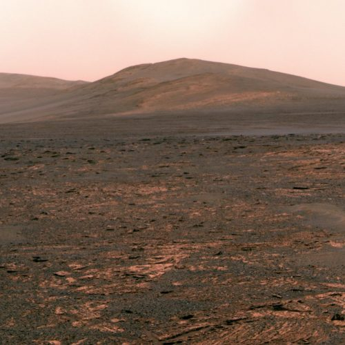 NASA's Mars Exploration Rover Opportunity used its panoramic camera (Pancam) to acquire this view of 'Solander Point.' The southward-looking scene, presented in true color, shows Solander Point on the center horizon.