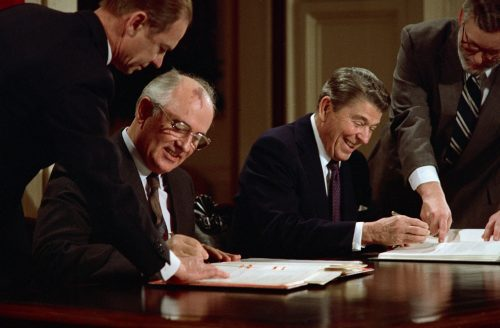 08 Dec 1987, Washington, DC, USA --- President Ronald Reagan and Soviet General Secretary Mikhail Gorbachev signing the arms control agreement banning the use of intermediate-range nuclear missles, the Intermediate Nuclear Forces Reduction Treaty. --- Image by © Bettmann/CORBIS
