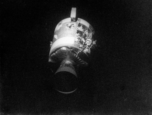 "AS13-59-8500A (17 April 1970) --- This view of the severely damaged Apollo 13 Service Module (SM) was photographed from the Lunar Module/Command Module (LM/CM) following SM jettisoning. As seen in this cropped image, enlarged to provide a close-up view of the damaged area, an entire panel on the SM was blown away by the apparent explosion of oxygen tank number two located in Sector 4 of the SM. Two of the three fuel cells are visible just forward (above) the heavily damaged area. Three fuel cells, two oxygen tanks, and two hydrogen tanks are located in Sector 4. The damaged area is located above the S-Band high gain antenna. Nearest the camera is the Service Propulsion System (SPS) engine and nozzle. The damage to the SM caused the Apollo 13 crew members to use the LM as a ""lifeboat"". The LM was jettisoned just prior to Earth re-entry by the CM. Photo credit: NASA"